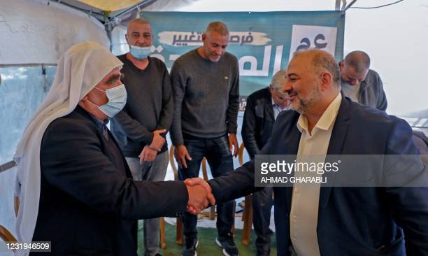 Mansour Abbas , head of Israel's conservative Islamic Raam party, is congratulated on the electoral victory in the northern Israeli village of Maghar...
