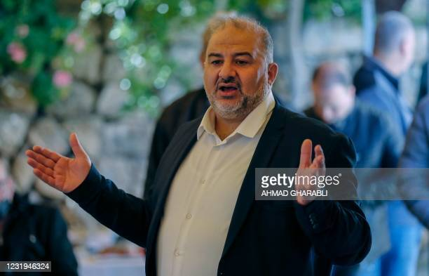 Mansour Abbas, head of Israel's conservative Islamic Raam party, speaks to a crowd during a political gathering to congratulate him on the electoral...