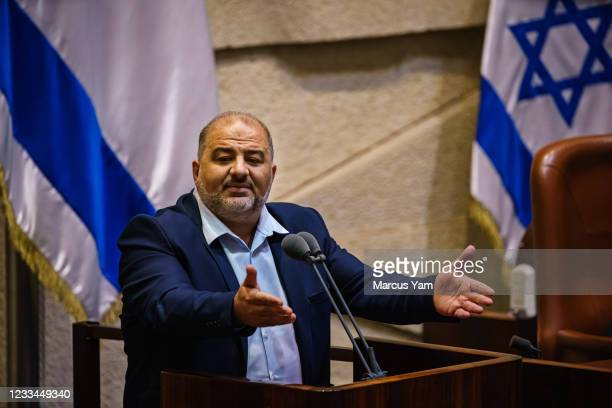 Mansour Abbas, leader of the Raam party, makes a speech to the Knesset, IsraelÕs parliament before it votes for the new coalition government in...