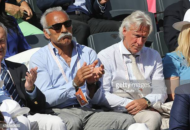 Mansour Bahrami and Bjorn Borg attend the men's final on day 15 of the French Open 2015 at Roland Garros stadium on June 56 2015 in Paris France