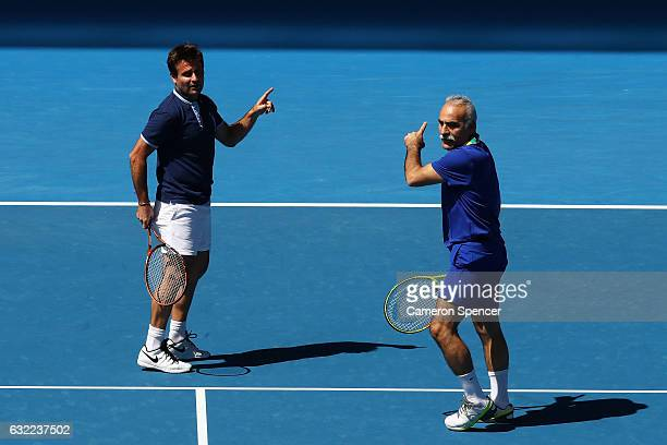 Mansour Bahrami and Fabrice Santoro of France compete in their legends match against John McEnroe and Patrick McEnroe of the United States on day six...