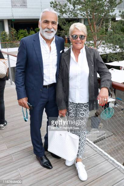 Mansour Bahrami and his wife Frederique Bahrami attend the 2019 French Tennis Open Day Six at Roland Garros on May 31 2019 in Paris France