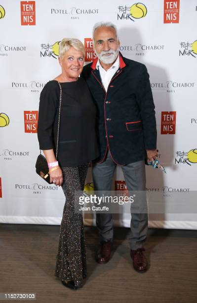 Mansour Bahrami and his wife Frederique Bahrami attend the gala for 'Fete le mur' an association founded by Yannick Noah to promote tennis in the...