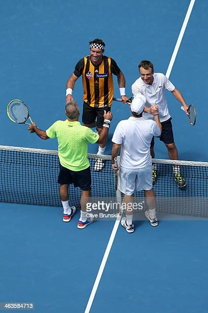 Mansour Bahrami Cedric Pioline Pat Cash and Mats Wilander shake hands after their second round legends doubles match during day seven of the 2014...