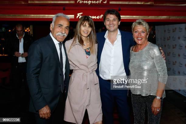 """Mansour Bahrami, Gabrielle Boetsch, Arnaud Boetsch and Frederique Bahrami attend """"Diner des Legendes"""" at Le Fouquet's on June 6, 2018 in Paris,..."""