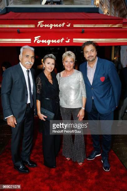 Mansour Bahrami Maria Dowlatshahi Frederique Bahrami and Henri Leconte attend Diner des Legendes at Le Fouquet's on June 6 2018 in Paris France
