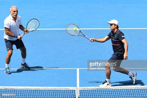 Mansour Bahrami of France and Fabrice Santoro of France compete in their legend's match against John McEnroe of the United States and Patrick McEnroe...