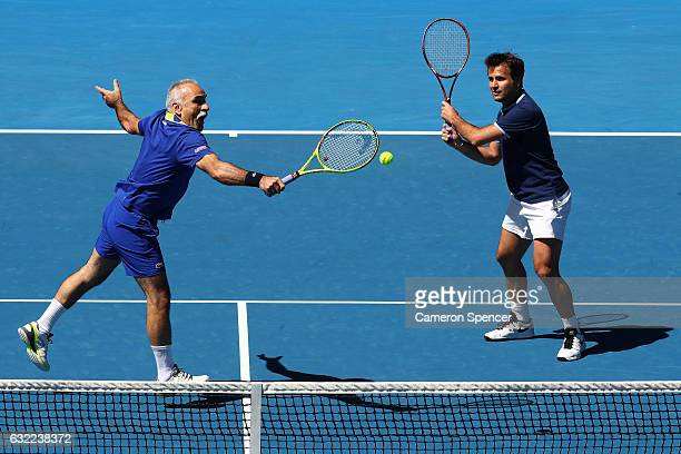 Mansour Bahrami of France competes in his legends match with Fabrice Santoro of France against John McEnroe and Patrick McEnroe of the United States...