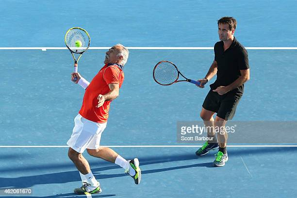 Mansour Bahrami of Iran and Fabrice Santoro of France in action in their legends doubles match during day six of the 2015 Australian Open at...