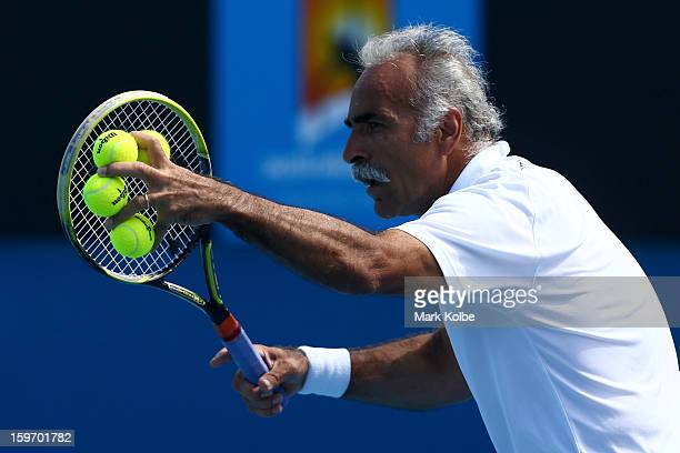 Mansour Bahrami of Iran prepares to serve in his legends doubles round one match with Wayne Ferreira of South Africa against Mark Woodforde of...