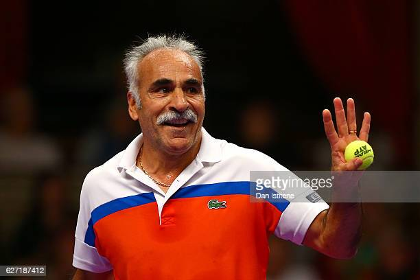 Mansour Bahrami of Iran reacts next to his partner John McEnroe of the United States during their doubles match against Henri Leconte of France and...
