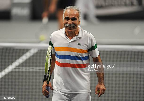 Mansour Bahrami of Iran smiles during the match against Wayne Ferreira of South Africa and Peter McNamara of Australia on Day Two of the Statoil...