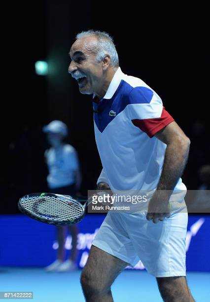 Mansour Bahrami partner of Tim Henman in action during their doubles match against Andy Murray and Jamie Murray during Andy Murray Live at The Hydro...