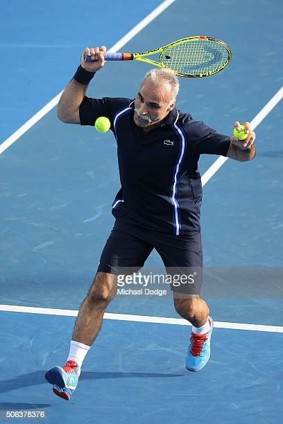 Mansour Bahrami plays a shot in his legends match with Guy Forget against Pat Cash and Goran Ivanisevic during day six of the 2016 Australian Open at...