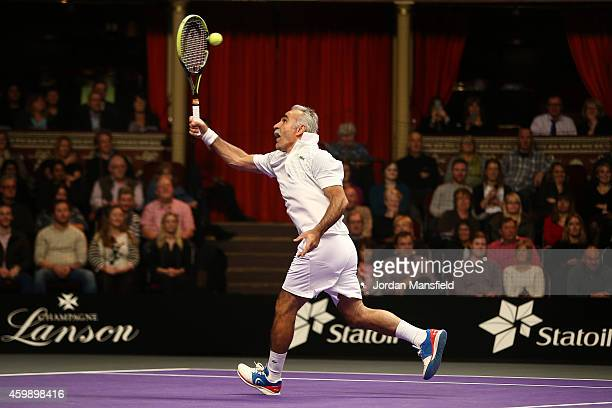 Mansour Bahrami plays a trick shot during the Mens Doubles match between Mansour Bahrami and Andrew Castle against Pat Cash and Peter McNamara on day...