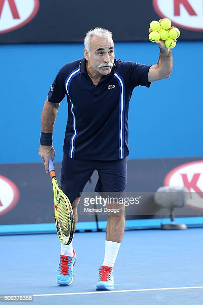 Mansour Bahrami serves in his legends match with Guy Forget against Pat Cash and Goran Ivanisevic during day six of the 2016 Australian Open at...