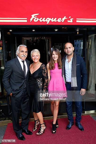 Mansour Bahramihis wife Frederique and his Son Sam Bahrami with his fiancee Gabrielle Picard attend the Trophee des Legendes Dinner at Le Fouquet's...