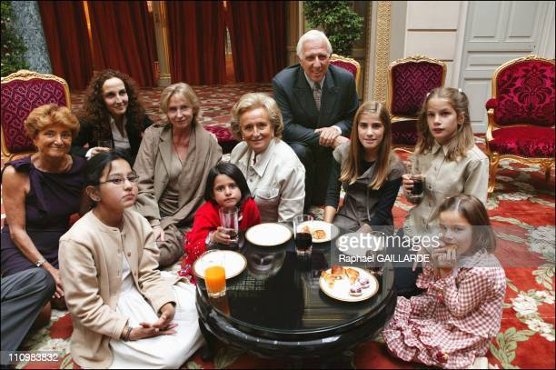 Mansoura Karima surrounded by their host families their children Pr Dr Deloche and Marine Jacquemin in Paris France on September 10 2003