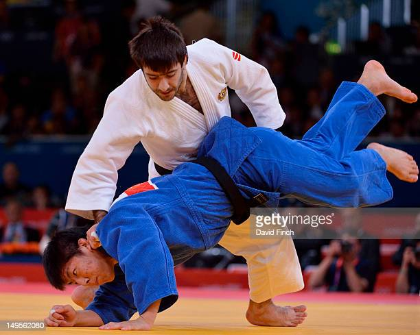 Mansur Isaev of Russia competes against Riki Nakaya of Japan during the Men's -73kg Judo on Day 3 of the London 2012 Olympic Games at ExCeL on July...