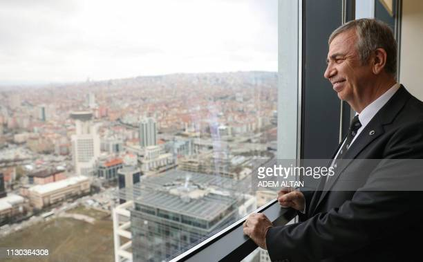 Mansur Yavas the mayoral candidate of the main opposition Republican Peoples Party poses after an interview with AFP in Ankara on February 14 2019