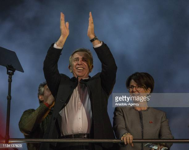 Mansur Yavas the mayoral candidate of the Republican People's Party greets the crowd from the election bus in front of the party headquarters in...