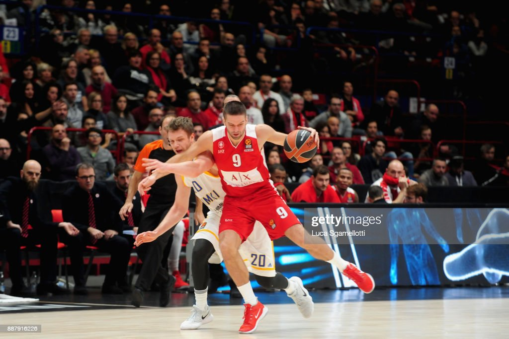 Mantas Kalnietis, #9 of AX Armani Exchange Olimpia Milan competes with Andrey Zubkov, #20 of Khimki Moscow Region during the 2017/2018 Turkish Airlines EuroLeague Regular Season Round 11 game between AX Armani Exchange Olimpia Milan and Khimki Moscow Region at Mediolanum Forum on December 7, 2017 in Milan, Italy.