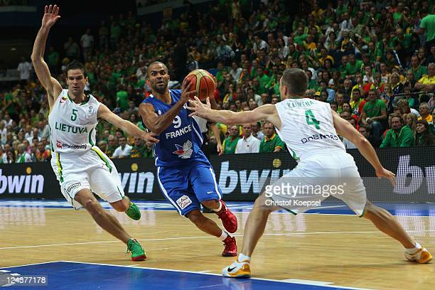 Mantas Kalnietis of Lithuania and Rimantas Kaukenas of Lithuania defend against Tony Parker of France during the EuroBasket 2011 second round group E...