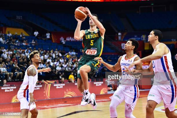 Mantas Kalnietis of Lithuania shoots the ball during FIBA World Cup 2019 Group L match between Dominican Republic and Lithuania at Nanjing Gymnasium...