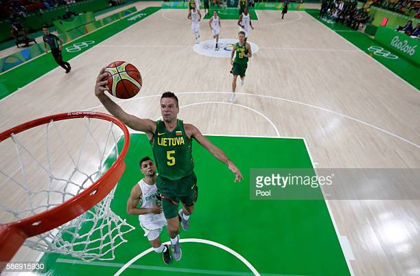 Mantas Kalnietis of Lithuania shots over Raulzinho Neto of Brazil during a Men's preliminary round basketball game between Brazil and Lithuania on...