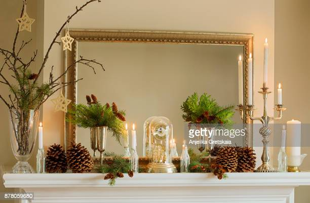 mantelpiece with christmas decor - christmas decore candle stock pictures, royalty-free photos & images