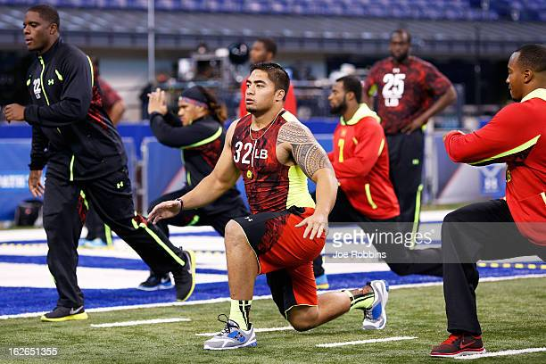 Manti Te'o of Notre Dame stretches with other linebackers during the 2013 NFL Combine at Lucas Oil Stadium on February 25, 2013 in Indianapolis,...
