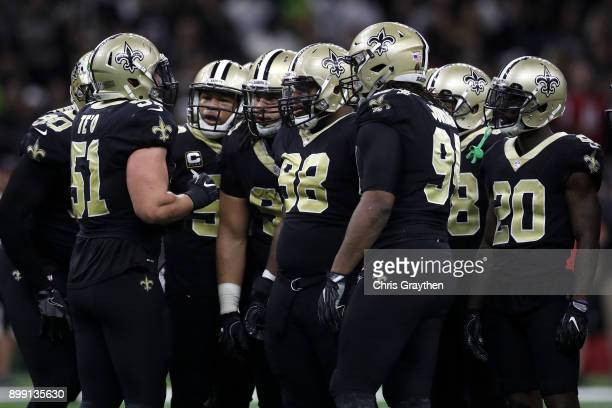 Manti Te'o of the New Orleans Saints talks with the defense duing the game against the Atlanta Falcons at MercedesBenz Superdome on December 24 2017...