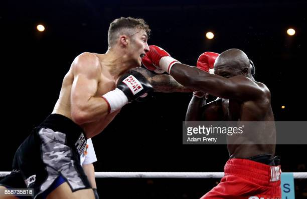 Mantingu Kindele of Belgium and Zach Parker of Great Britain exchange punches during their Super Middleweight fight at HannsMartinSchleyer Halle on...