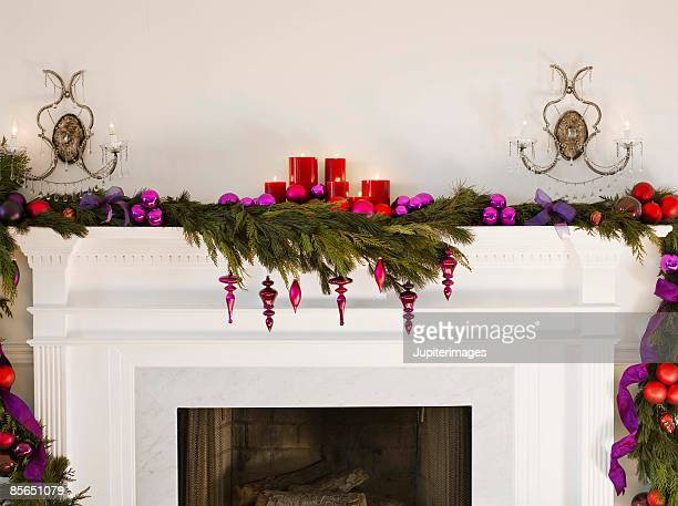 Mantle and fireplace with holiday decorations