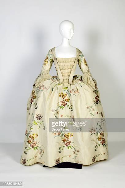 Mantua, two-piece dress, body and skirt of cream-colored silk with colored floral scrolls, stomach piece set with tulle, tulle engagements on the...