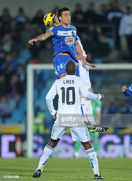 Manu de Moral of Getafe heads the ball in front of Lass Diarra of Real Madrid during the La Liga match between Getafe and Real Madrid at Coliseum...