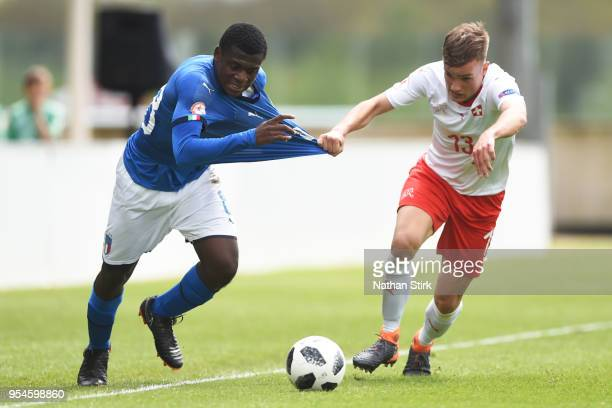 Manu Emmanuel Gyabuaa of Italy battles for posession with Jan Wornhard of Switzerland during the UEFA European Under17 Championship Group A match...