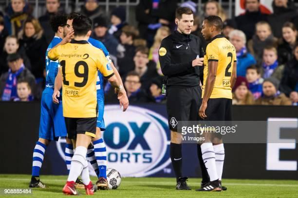 Manu Garcia of NAC Breda referee Jochum Kamphuis Fabian Sporkslede of NAC Breda during the Dutch Eredivisie match between PEC Zwolle and NAC Breda at...