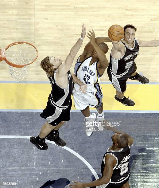 Manu Ginobili and Fabricio Oberto of the San Antonio Spurs block Lorenzen Wright of the Memphis Grizzlies on February 24 2006 at FedExForum in...