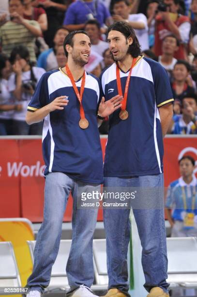 Manu Ginobili and Luis Scola of Argentina celebrates winning the men's bronze medal at the 2008 Beijing Olympic Games at the Beijing Olympic...