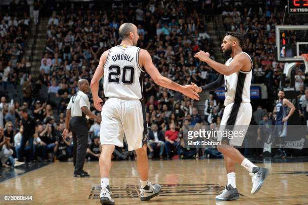 Manu Ginobili and Patty Mills of the San Antonio Spurs react to a play during Game Five of the Western Conference Quarterfinals of the 2017 NBA...