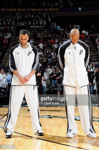 Manu Ginobili and Richard Jefferson of the San Antonio Spurs stand for the national anthem before the preseason game against the Houston Rockets on...