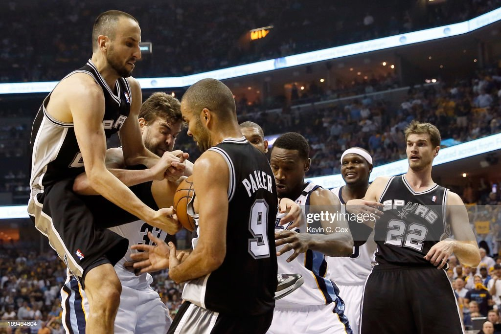 Manu Ginobili #20 and Tony Parker #9 of the San Antonio Spurs go for the ball against Marc Gasol #33 of the Memphis Grizzlies in the fourth quarter during Game Three of the Western Conference Finals of the 2013 NBA Playoffs at the FedExForum on May 25, 2013 in Memphis, Tennessee.