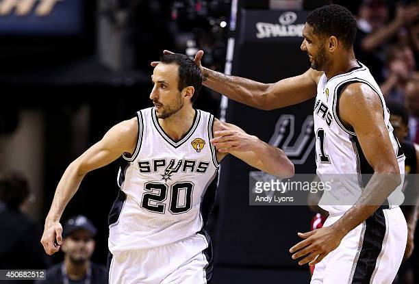 Manu Ginobili celebrates with Tim Duncan of the San Antonio Spurs after hitting a shot against the Miami Heat during Game Five of the 2014 NBA Finals...