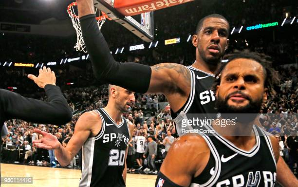Manu Ginobili LaMarcus Aldridge and Patty Mills of the San Antonio Spurs celebrate after winning Game Four of Round One of the 2018 NBA Playoffs...