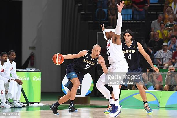Manu Ginobili of Argentina dribbles the ball against Carmelo Anthony of the USA Basketball Men's National Team during the Quarterfinals on Day 12 of...