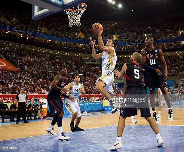 Manu Ginobili of Argentina drives for a shot attempt against Jason Kidd and Kobe Bryant of the United States during a men's semifinal baketball game...