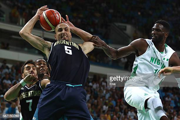 Manu Ginobili of Argentina fights for the ball against Ekene Ibekwe of Nigeria during a Men's preliminary round basketball game between Nigeria and...