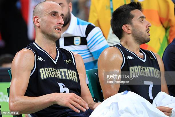 Manu Ginobili of Argentina sits on the bench while taking on the United States during the Men's Basketball Quarterfinal game at Carioca Arena 1 on...