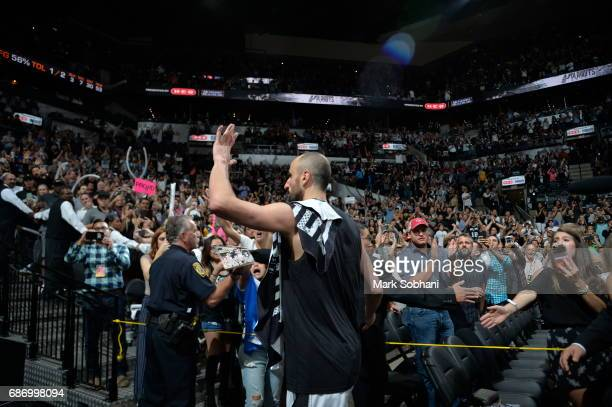 Manu Ginobili of the San Antonio Spurs address the crowd after the game against the Golden State Warriors during Game Four of the Western Conference...